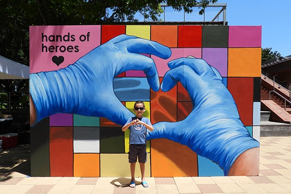 The story behind the Hands of Heroes mural at Discovery Green